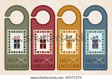 Vintage style 'Do Not Disturb' door hangers. Christmas concept with 'not' crossed out inviting Santa to enter. Also available in vector format. - stock photo