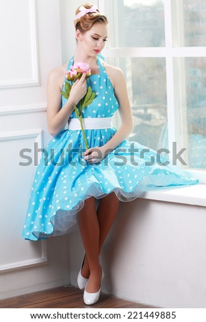 Vintage style fashion portrait of cute sad blonde teenager girl