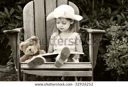 Vintage style image of a child reading to her teddy bear - stock photo