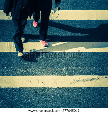 Vintage style image of pedestrians people moving at zebra crosswalk. Hong Kong. Crowded city abstract background - stock photo