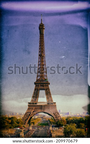 Vintage style image of the Eiffel Tower in Paris, France on a background of the blue sky - stock photo