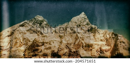 Vintage style image of the world's highest mountain, Mt Everest (8850m) and Mt. Nuptse in the Himalayas, Nepal. - stock photo