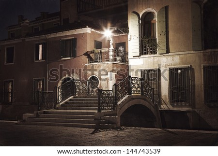 Vintage style image of Venice street at night, Venice, Italy - stock photo