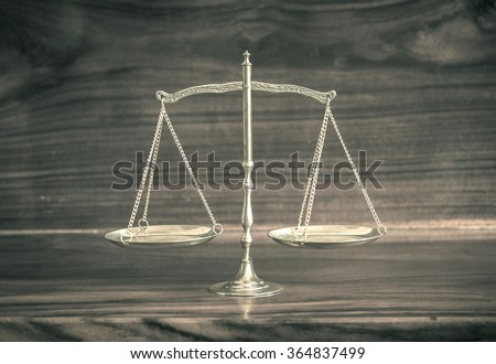 Vintage style. Law scales on wooden table. Symbol of justice concept. World Day of Social Justice concept. - stock photo