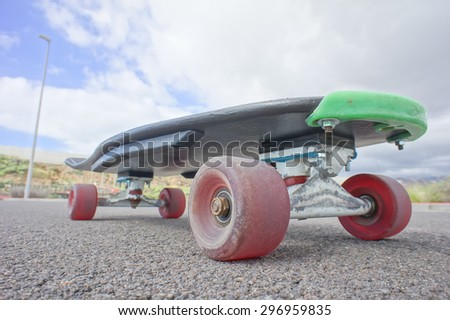 Vintage Style Longboard Black Skateboard on an Empty Asphalt Desert Road - stock photo