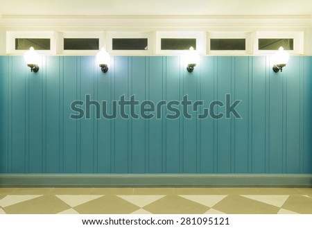 vintage style of decorative blue wall and lighting in the room - stock photo