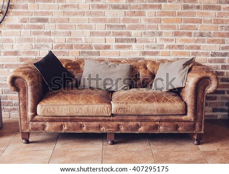 vintage style of interior decoration the leather sofa in room - stock photo