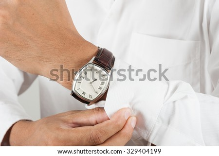 vintage style of luxury men watch on wrist - stock photo