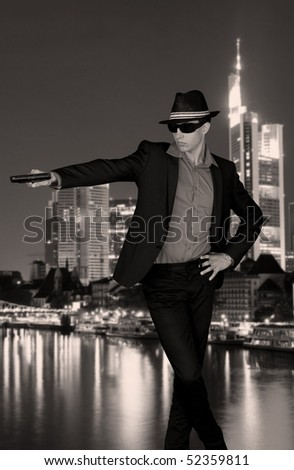 Vintage style photo of a gangster in a big city - stock photo