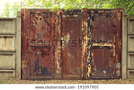 Vintage style photo of a rusty gate - stock photo