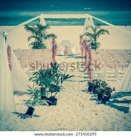 Vintage style photo of wedding altar on the beach - stock photo
