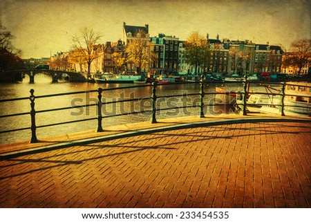 vintage style picture of a city view with canals in Amsterdam, Netherlands - stock photo