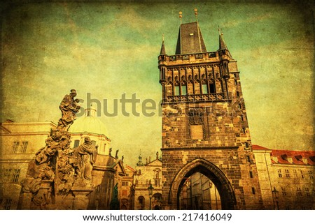 vintage style picture of a historical bridge tower of the famous Charles bridge in the UNESCO protected city centre of Prague, Czechia - stock photo