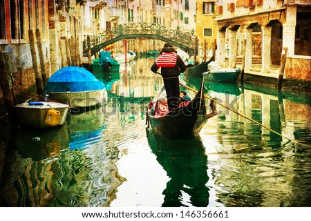 vintage style picture of a typical canal in Venice, Italy, with a gondolier who carries a gondola with passengers - stock photo