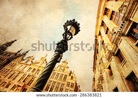 vintage style picture of historical guildhalls at the Grand Place in Brussels, Belgium - stock photo