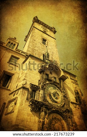 vintage style picture of the City Hall Tower with famous astronomical clock in Prague, Czechia - stock photo