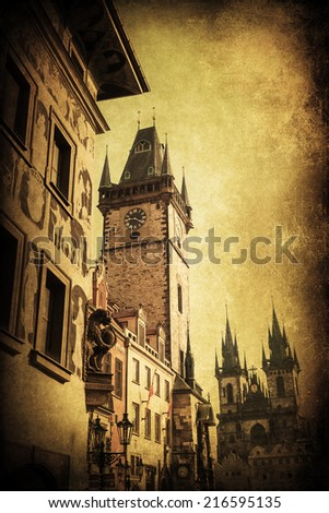 vintage style picture of the tower of the historical City Hall at the Old Town Square in Prague, Czechia - stock photo