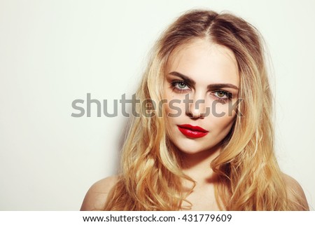 Vintage style portrait of young beautiful girl with long messy hair and red lips