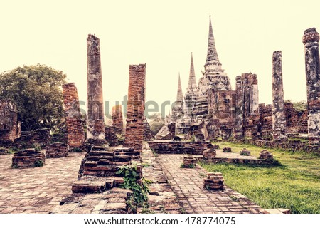 Vintage style ruins and pagoda ancient architecture of Wat Phra Si Sanphet old temple famous attractions during sunset at Phra Nakhon Si Ayutthaya Historical Park in Ayutthaya Province, Thailand