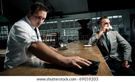Vintage style, 70's barista and businessman in and industrial style cafe - stock photo