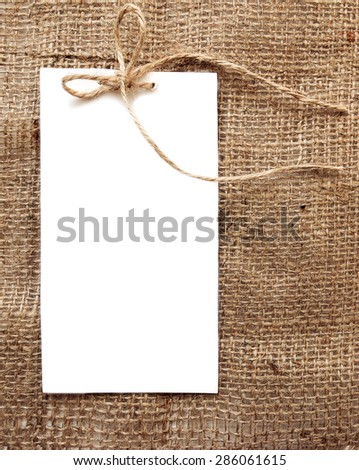 Vintage style sale tags design on rustic burlap background, can use for congratulation or invitation white card,  eco friendly concept.  - stock photo