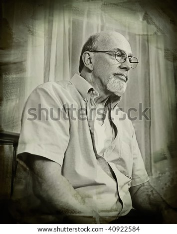Vintage style sepia grunge portrait of a distinguished looking senior man thinking seriously about life.