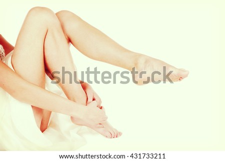 Vintage style shot of long slim smooth woman's legs - stock photo