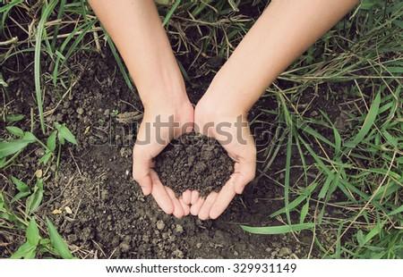 Vintage Style,Soil- handful,female hands, humus soil - stock photo