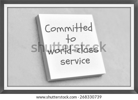 Vintage style text committed to world class service on the short note texture background - stock photo