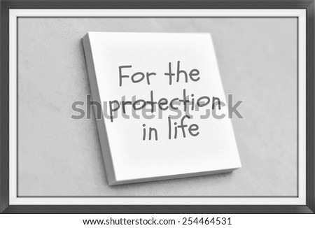 Vintage style text for the protection in life on the short note texture background - stock photo