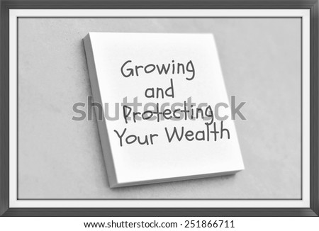 Vintage style text growing and protecting your wealth on the short note texture background - stock photo