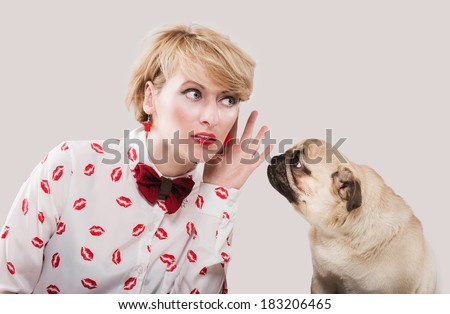 Vintage style woman listening to her dog  - stock photo