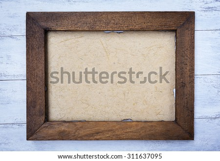 Vintage style wooden frame with natural paper texture  - stock photo