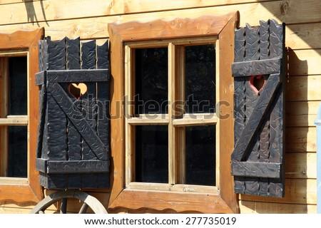 Vintage style wooden window  shutters. Window shutters. - stock photo