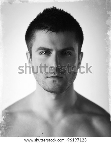 Vintage stylized fine art close-up black and white portrait of beautiful young man, shallow deep of field - stock photo