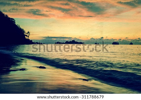 Vintage stylized photo add texture, Colourful of morning sky before sunrise on the beach at Honeymoon Bay on Ko Miang island in Mu Koh Similan National Park, Phang Nga Province, Thailand