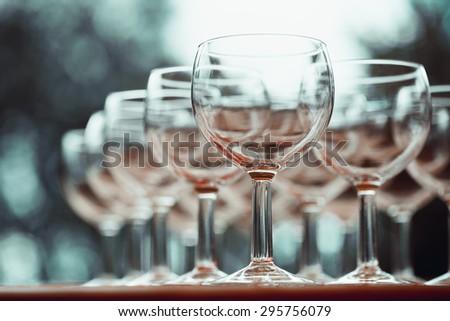 Vintage stylized photo on wine glasses. Selective focus. - stock photo