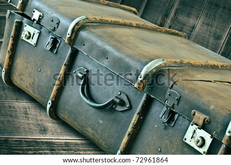 Vintage Suitcase a on wooden planks background. Closeup