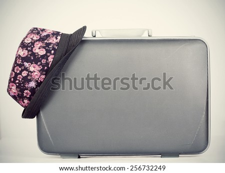 Vintage suitcase and hat with retro effect - stock photo