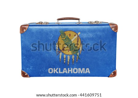 Vintage suitcase with Oklahoma flag - stock photo
