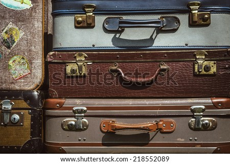 vintage suitcases stacked up, vintage filter effect added. - stock photo