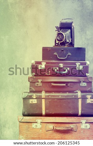 Vintage suitcases with camera - stock photo