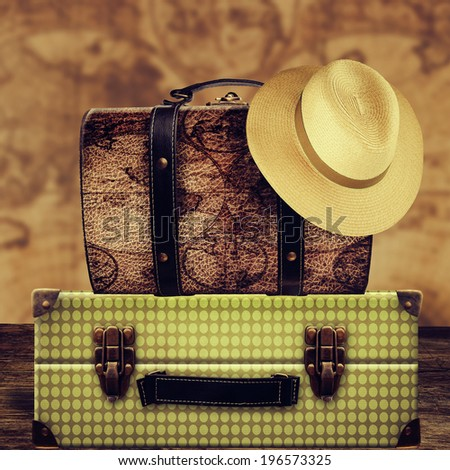Vintage suitcases with hat.  - stock photo
