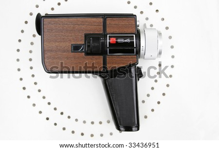 Vintage Super 8 movie camera on white - stock photo