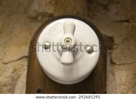 Vintage switch. Antiquated old bakelite white switch - stock photo