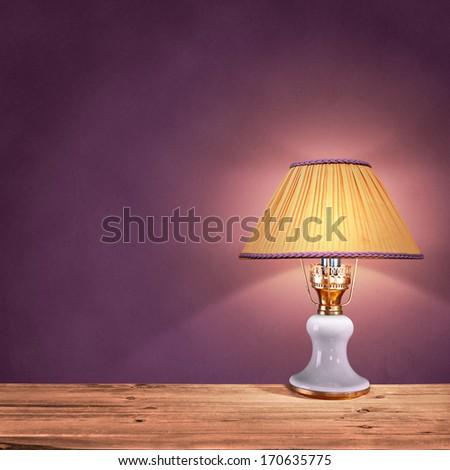 vintage table lamp on purple background - stock photo