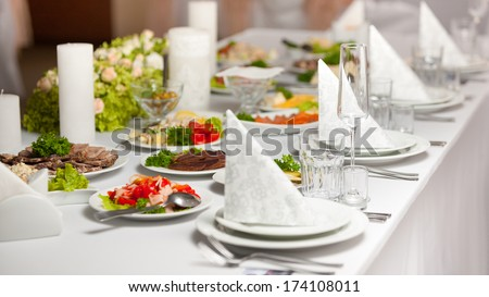 Vintage Table set for an event party or wedding reception - stock photo