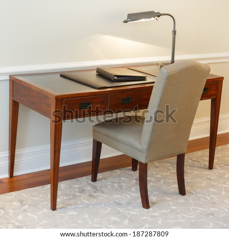 Vintage table with chair in the hotel room - stock photo