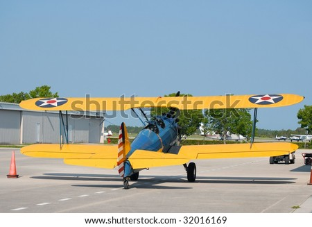 Vintage taildragger aircraft parked at an airport - stock photo
