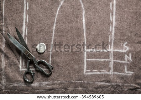 Vintage tailor pattern trousers with cloth, scissors and chalk - stock photo
